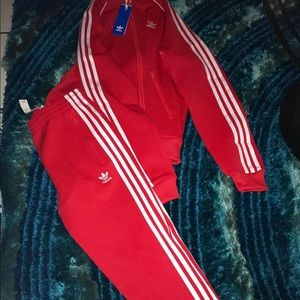 Adidas woman's track  suit